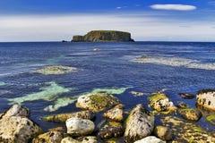 Sheep Island the Rocky Antrim Coast. Sheep Island Carrick a Rede, Antrim Coast Northern Ireland. The Antrim Coast is one of the most popular tourist destinations stock images