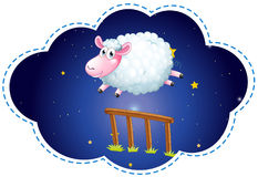 Sheep jumping over the fence at night Royalty Free Stock Photo