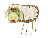 Sheep made with bread and cheese. On white background Stock Images