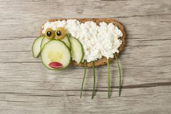 Sheep made with bread and cheese. On wooden background royalty free stock image