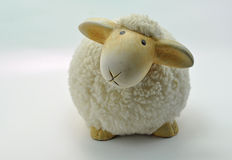 Sheep made from ceramic. Against a blue background Royalty Free Stock Photo