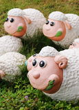 Sheep. Middle size garden outdoor decorative figure, group of white fat cute round body sheep with dark dots, smiling pink face round big eyes with costume royalty free stock photo