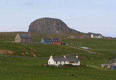 Community houses and rock promontory Royalty Free Stock Photo
