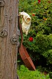 A sheep`s skull and a frying pan, farmyard decorations. stock photo