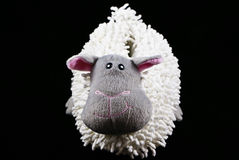 Sheep slipper. One sheep slipper on black background Royalty Free Stock Images