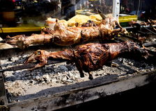 Sheep on a spit. Whole sheep of roasting on a spit Stock Photo