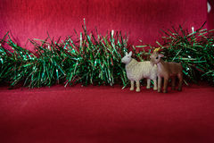 Sheep symbol of the year garland tinsel blur on a red background Stock Images