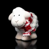 Sheep the symbol 2015 year. White sheep toy the Chinese symbol of 2015 year on black background stock photo