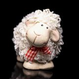 Sheep the symbol 2015 year. White sheep toy the Chinese symbol of 2015 year on black background royalty free stock photography
