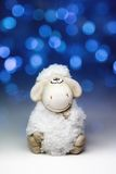 Sheep the symbol 2015 year. White sheep toy the Chinese symbol of 2015 year on blurred lights background stock images