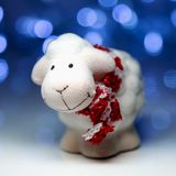 Sheep the symbol 2015 year. White sheep toy the Chinese symbol of 2015 year on blurred lights background royalty free stock photos
