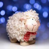 Sheep the symbol 2015 year. White sheep toy the Chinese symbol of 2015 year on blurred lights background stock photos
