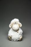 Sheep the symbol 2015 year. White sheep toy the Chinese symbol of 2015 year on gray background royalty free stock photos
