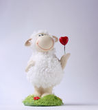 Sheep toy. With heart on the white background Stock Images