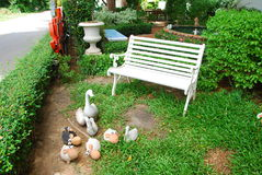Sheep toys and chair in garden. The are sheep toys and chair in thai style garden.this place is in east of thailand Royalty Free Stock Photography