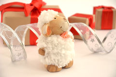 Sheep. The sheep is white and fluffy with gifts symbol 2015 stock photo