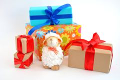 Sheep. The sheep is white and fluffy with gifts symbol stock photo