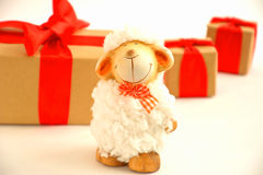 Sheep. White sheep near the gifts are red bows stock photos
