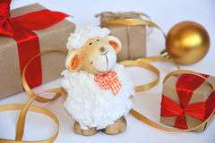 Sheep. White sheep is a symbol of new year gifts stock photography