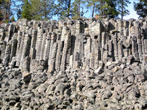 Sheepeater Cliffs in Yellowstone National Park (Wyoming, USA). Columnar basalt at Sheepeater Cliff in Yellowstone National Park (Wyoming, USA Stock Photography