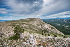 A view towards Mrgar, a sheepfold in a shape of flower, in the karst landscape above Baska, Island of Krk, Croatia royalty free stock photo
