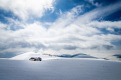 Sheepfold in the mountains in winter. Stock Photos