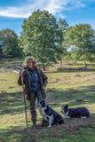 Sheepherder herding her sheep at Veluwe national park 9-2018 stock image