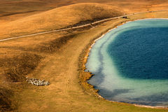 Sheeps on pasture near the lake on highland Royalty Free Stock Image