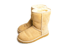 Sheepskin boots isolated on white royalty free stock image