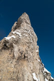 Sheer cliff against dramatic blue skies royalty free stock photos
