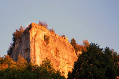 Sheer cliff in the setting sun. Against the blue sky in the central Crimea Royalty Free Stock Photography