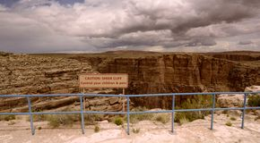 Sheer Cliff. Sign warning of sheer cliff at Little Colorado River Gorge in Arizona Stock Images