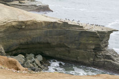 Sheer cliffs resulting from erosion caused by Pacific Ocean Stock Image