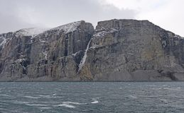 Sheer Cliffs in a High Arctic Fjord Royalty Free Stock Photo