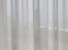 Sheer curtain designer interior background. Background image of a sheer designer curtain in a new apartment Royalty Free Stock Images