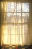 Sheer curtains through paned window Stock Photo