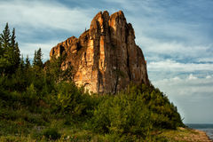 Sheer limestone cliffs and forest. National Park Lena pillars. Yakutia. Russia Stock Image