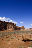 Sheer mesa cliffs in desert. A view across dry desert to abrupt rock formations often called mesas or buttes Stock Images