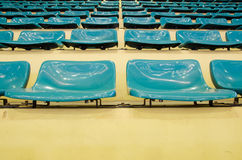 Sheer seats. Arranged in a row and sheer sport indoor stock photos
