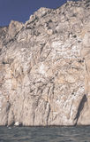 Sheer stone cliff filter Royalty Free Stock Photos