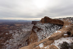 Sheer Wall Drop Off Canyonlands. Unique geologic formations in Canyonlands. Big canyon wall that has a fresh dusting of snow Royalty Free Stock Images