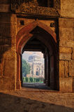 Sheesh Gumbad at early morning in Lodi Garden Monuments. View through window, Delhi, India stock photos