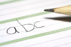 Sheet with abc. Close-up of a sheet with letters and a pencil Stock Images