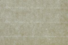 A sheet of ancient laid paper as background. Cellulose fibers are clearly visible when light penetrates through a sheet of ancient laid paper. Laid paper .is a stock photography