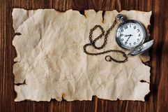 Sheet of ancient parchment and pocket watch Royalty Free Stock Photography