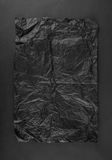 Sheet of black crumpled paper on black Royalty Free Stock Images