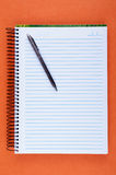 Sheet of blank notebook and pen Stock Photos