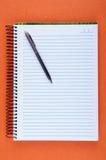 Sheet of blank notebook and pen Stock Photos