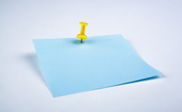 Sheet of blue paper witn push pin Royalty Free Stock Image