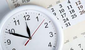 Sheet of a calendar with clockface Royalty Free Stock Photography